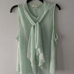 Light green sleeveless blouse